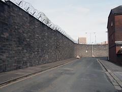 boundary wall (chrisinplymouth) Tags: wall security razorwire street road urban devonport plymouth devon england uk cw69x ground pavement stone plymgrp bef