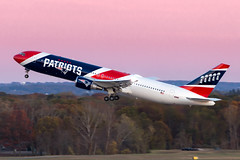 Patriots N36NE (tkolos) Tags: patriots newengland newenglandpatriots football b767 767 boeing sunset departure flying avgeek travel pink sports superbowl takeoff airline airport canon 6d