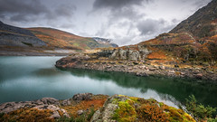 Tranquility (Einir Wyn Leigh) Tags: landscape wales exposure light colorful mountains quarry rural rugged water lake uk britain autumn november nature natural outside nikon sigma clouds weather climate foliage green blue rocks valley dof island