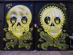 Saki & B (Steve Taylor (Photography)) Tags: sakib skull numbers actionspeaklouderthanwords padlock horns art graffiti mural streetart sticker black yellow white ladies bra tail teeth