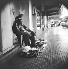 En la calle... (mavricich) Tags: calle street holga kodak 120 nativo vendedor monocromo iguazu misiones argentina