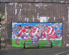 Rugby-themed artwork/mural on a wall (southglosguytwo) Tags: 2017 december gloucester artwork mural wall bench city rugbyrelated graffitiart