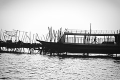 The ultimate playground ~ Cambodia (~mimo~) Tags: happy playful playground play boat water blackandwhite running child stilts lines asia cambodia travel trip