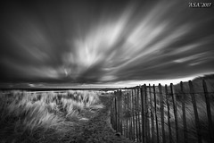 "Gusty (""A.S.A."") Tags: sanddune dunes crimdonbeach hartlepool cleveland teeside britain cloud longexposure slow shutter fence leefilters leebigstopper nd110 neutral density sonyzeissvariotessarfe1635mmf4 infrared830nm sonya7rinfrared830nm blackwhite mono monochrome greyscale niksoftware silverefex asa2017"