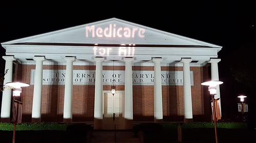 Maryland Solidarity Brigade Guerrilla Light Projections calling for Single Payer Now and Medicare For All at university of maryland school of medicine