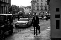 Brolly and Briefcase (Foto John) Tags: leicam leicam240 leica leicamtyp240 rangefinder elmaritm90mmƒ28 bw blackwhite blackandwhite blackandwhitethatsright monochrome streetphotography people man street cars vehicles buildings london uk backlight tegenlicht zwartwit zw