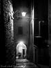 Vicolo Farnese - Latera (VT) (frillicca) Tags: 2017 agosto alley august bn bw biancoenero blackandwhite lamp lampione lateravt light luce monochrome monocromo night notte panasoniclumixlx100 tuscia vicolo