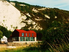 Grand Design (teaselbrush) Tags: uk britain england town urban lewes east sussex south downs limestone chalk cliffs modern house building architecture red green river riverside ouze bank riverbank glass windows boat