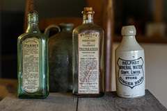 Cures from the past - Anderson S.C. (DT's Photo Site - Anderson S.C.) Tags: canon 6d sigma 50mm14 art lens andersonsc upstate medicine cardui wampoles ginger beer cures alcohol bitters preparation vintage aged bottles drugs old antique southern appalachia america usa traveling vendor pharmacy