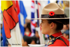 Lady Officer Standing In Front of Flags - Remembrance XT5117e (Harris Hui (in search of light)) Tags: harrishui fujixt1 digitalmirrorlesscamera fuji fujifilm vancouver richmond bc canada vancouverdslrshooter mirrorless fujixambassador xt1 fujixcamera fujixseries fujix fuji55200mmf3548 fujizoomlens bokeh portrait officer flags remembrance remembranceday richmondcityhall ceremony tribute lestweforget depthoffield woman