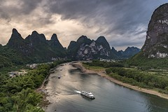 *Li River Impression* (albert.wirtz) Tags: china albertwirtz landscape river tree forest boat ships schiffe mountain liriver eveningmood sunset sonnenuntergang twilight reflections spiegelung nikon d810 d810landscape paesaggi paysagens asia asien yangshuo yangshuocounty xianggongshan guangxi guilin drama dramatic dramatik goldenhour goldenestunde stream liriverimpression abendstimmung themiddlecountry themiddlekingdom natur nature natura tourism tourismus reisen traveling explore entdecken landscapephotography photography landschaftsfotografie