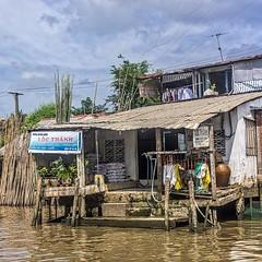 Waterfront Business, Cai Be (gecko47) Tags: waterfront caibe vietnam shop house dock piles potplants merchandise river mekongriver mekongdelta