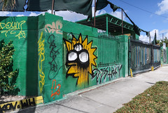 The famous 3-eyed Lisa Simpson DESTR★Y streetart at the corner of N Miami Ave and NW 20th St in Miami. (Tim Kiser) Tags: 2000 2017 20170414 20thstreet 3eyes 3eyed 3eyedlisasimpson april april2017 destroy dadecounty dadecountyflorida florida img9941 lisa lisasimpson miami miamiavenue miamiflorida miamidade miamidadecounty miamidadecountyflorida northmiamiavenue northmiamiand20th northwest20thstreet simpsons thesimpsons wynwood wynwoodneighborhood addressnumber bollards drippingpaint drippingpaintartwork eyeswithnoirises eyeswithnopupils gate graffiti graffititags greenpaint greenwall heartshape paintdrips paintdripsartwork partlycloudy sidewalk southflorida southernflorida tags threeeyes threeeyed threeeyedlisasimpson