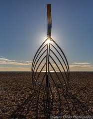 Starburst through Norman Longboat Sculpture (sarahOphoto) Tags: 6d canon east hastings kingdom sussex uk united norman long boat sculpture beach shingle pebbles sea art sunburst starburst sun blue sky anniversary 950th 1066 leigh dyer longboat outdoors landscape coast seaside