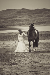 "unexpected sight on Newburgh beach on a bitterly cold winter day - woman, wedding dress and horse in black & white. Aberdeenshire, Scotland (grumpybaldprof) Tags: woman horse wedding dress weddingdress bride aberdeenshire scotland newburgh ""sandsofforvienaturereserve"" beach sand sea ""northsea"" ""ythanriver"" sky clouds perspective north estuary colour sun patterns texture landscape seascape bw ""blackwhite"" monochrome noireetblanc blackwhite ""blackandwhite"" ""fineart"" striking artistic interpretation impressionist stylistic style contrast shadow bright dark black white illuminated unexpected suprising canon 7d ""canon7d"" tamron 16300 16300mm ""tamron16300mmf3563diiivcpzdb016"""