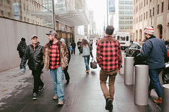 Lumbersexuals (instagram.com/lanolan) Tags: 185mmf28 28mmequiv color day downtown downtownfinancial downtownmanhattan fujifilmx70 lowermanhattan manhattan newyork newyorkcity newyorknewyork ny nyc outdoors outside people plaid red thebigapple