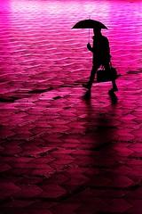 The floor is made of lava (Birdhouse camper) Tags: copenhagen denmark light color street silhouette pink umbrella human fujifilm fujixt2 fuji xt2