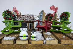 Christmas ON A Crate (jah32) Tags: frosty frostythesnowman miniature chairs chair muskokachairs muskokachair red green snow cottage wood weatheredwood weathered crate stilllife tabletop table onthetable christmas merrychristmas ornaments rustic