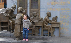 Life imitating art? (DepictingPhotos) Tags: asia children china lijiang sculpture