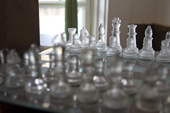 Glass Chess Set, Flint Hill (dckellyphoto) Tags: chess glass chessset flinthill flinthillvirginia virginia stilllife shallowdof light white window board game skywardcafe cafe pieces pawn knight queen king bishop rook backlit