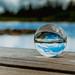 Beautiful sky reflected in glassball