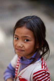 Little Nepali girl posing in old Newari style street, Dhulikhel, Nepal 1