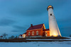Twilight Lighthouse (matthewkaz) Tags: lighthouse tawaspointlighthouse tawas michigan tawaspointstatepark statepark winter snow dusk evening sky clouds sunset 2010