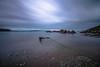 First light on the shore (NikNak Allen) Tags: devon cornwall cawsands cawsandsbay bay coast sea water ocean rocks stones beach sand horizon sky sun clouds sunrise seascape longexposure