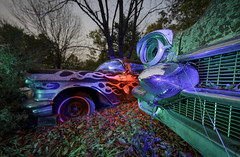 RGB Cadillacs (Notley Hawkins) Tags: httpwwwnotleyhawkinscom notleyhawkinsphotography notley notleyhawkins 10thavenue lightpainting car auto boneyard abandoned trees fall outdoors sky 2017 november night nocturne evening salvage salvageyard junkyard cadillac flames tree rgb red green blue light grill bumper headlight