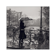 Autumn in Amsterdam (Nico Geerlings) Tags: ngimages amsterdam rain raining rainy autumn nicogeerlingsphotography canals bridges silhouette holland
