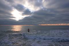 Black Friday swim (beyondhue) Tags: southwest florida coast beach ocean gulf wave sunset beyondhue horizon cloud reflection swimmer person usa travel roadtrip
