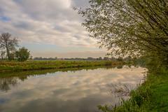Autumn sky (stevefge) Tags: beuningen industrieterrein nederland netherlands nl nederlandvandaag reflectyourworld reflections trees bomen cloud pond water autumn herfst landscape glow