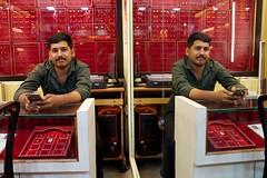 Seeing double (ambfotos1) Tags: ernakulum india street portrait market jewelry seller jeweler mirror image seeing double