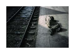 The dark side of the sun...2 ( Calcutta ) 1994 (José Luis Cosme Giral) Tags: thedarksideofthesun2 travel sadlives street howrahstation olympus xa2 kodachrome200 scanned 1994 calcutta india man document