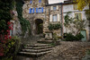 Naves High Street (cliveg004) Tags: naves lesvans ardeche rhonealpe france villageofcharacter stonebuildings alleyways autumn leaves shutters cobbles cross creepers nikon d5200