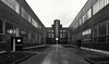 Zeche Zollverein (frankdorgathen) Tags: zeche zollverein essen stoppenberg ruhrgebiet monochrome blackandwhite architecture building stone brick perspective wideangle autumn rain path outdoor city urban town door window
