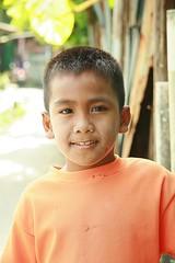 handsome boy in orange (the foreign photographer - ฝรั่งถ่) Tags: handsome boy orange shirt khlong thanon portraits bangkhen bangkok thailand canon