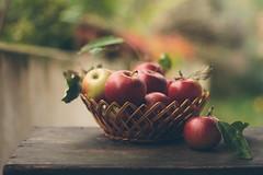 Freshly picked apples (Inka56) Tags: 7dwf macroorcloseup hbw apple basket basketwithfruits woodtable fruit bokeh closeup leaf stilllife throughherlens bokehpainting