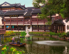 Yu Garden, Shanghai (Ray in Manila) Tags: shanghai yugarden china yuyuan water boat people statue lotusleaf building architecture historical touristy