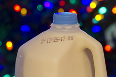 Merry Christmilk (brucetopher) Tags: milk jug bottle plastic container skimmilk 122517 12252017 date christmasday sellby expires shelflife bokeh lights christmas holiday festive dairy drinkbychristmas drink beverage sparkle lighting light christmaslights led energy