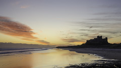 Bamburgh Castle (in explore) (pedalpusher139) Tags: sunrise castle northumberland beach sea outdoors landscape
