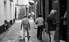 Andalucia (thedailyjaw) Tags: cadiz andalucia spain europe d610 85mm nikon streetphotography street people city alleyway cobbledroad mist bw blackwhite cane money exchange sitting blackandwhite