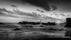 rocks in the sea (hjuengst) Tags: beach beautyofwater ocean southafrica plettenbergbay keurboomstrand blackandwhite clouds cloudy rocks wave