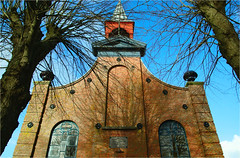 the church tower.......... (atsjebosma) Tags: church reflections windows bomen takken branches kerk toren ramen 1862 atsjebosma groningen thenetherlands denhorn