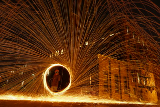 Fire Spinning in front of Industrial building