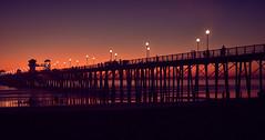 Evening walk on the beach (Zara Calista) Tags: san diego california beach shore night light red purple silhouette nikon d750 sigma 50mm f14