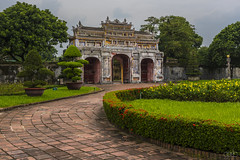 20171103_1186 (lgflickr1) Tags: vietnam hue old citadel imperial weathered worn deteriorated asia historic palace overcast clowdy sidewalk bricks flowers plants