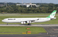 Mahan Air A340-300 EP-MMT (birrlad) Tags: dusseldorf dus international airport germany aircraft aviation airplane airplanes airline airliner airlines airways taxi taxiway arrival arriving landed runway stand gate terminal airbus a340 a343 a340300 a340313 mahan air epmmt tehran iran