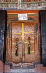 Wooden door & decoration (bag_lady) Tags: woodendoor buddhism ladakh chemremonastery chemregompa buddhist ancientdoor doorway entrance
