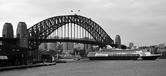 Maasdam departing Sydney 2 (PhillMono) Tags: dslr nikon d7100 sydney new south wales australia history heritage harbour ship boat vessel cruise maasdam holland america bridge black white sepia monochrome light shade architecture